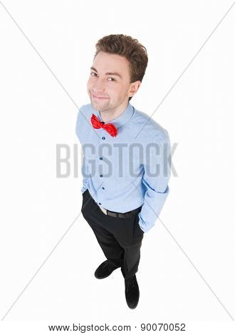 Smiling businessman in a bow tie looking up. top view. Isolated on white background.
