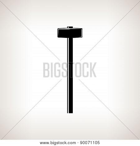 Silhouette sledgehammer on a light background