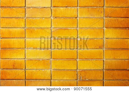 Wall bricks cubes golden brown for the background.