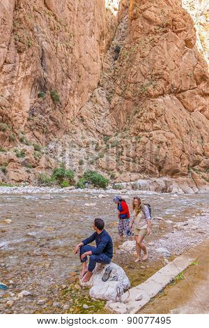 Young tourist enjoying river in Todgha Gorge, Morocco