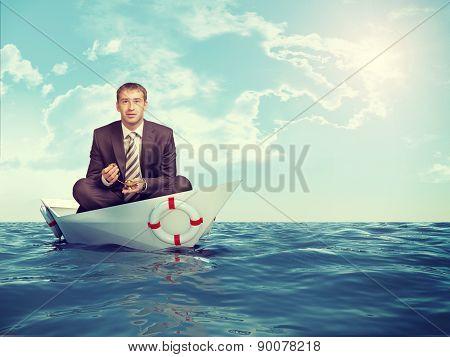 Businessman sitting in lotus position