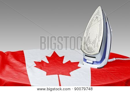 Preparing To Smooth Out The Wrinkles Of Flag-canada