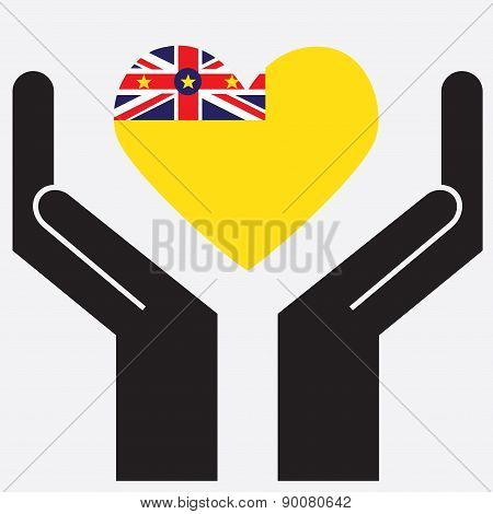 Hand showing Niue flag in a heart shape.