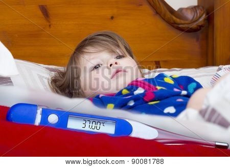 Electronic Thermometer And A Little Sick Girl