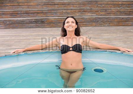 Beautiful woman in bikini relaxing in swimming pool