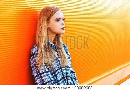 Outdoor Fashion Portrait Of Pretty Woman In The City Against The Colorful Orange Wall