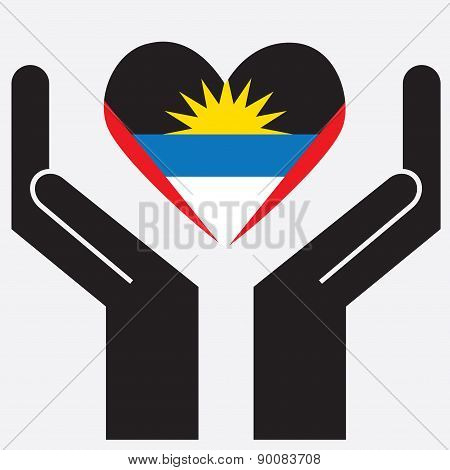 Hand showing Antigua and Barbuda flag in a heart shape.