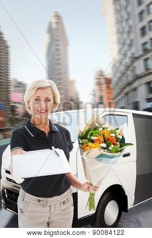Happy flower delivery woman looking for signature against new york street