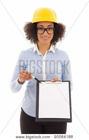 Beautiful African American Business Woman In Builder Helmet Showing Blank Clipboard And Giving Pen I