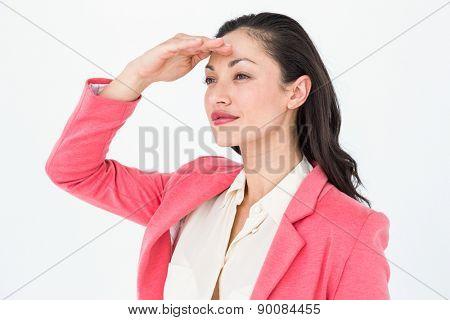 Elegant brunette looking away on white background