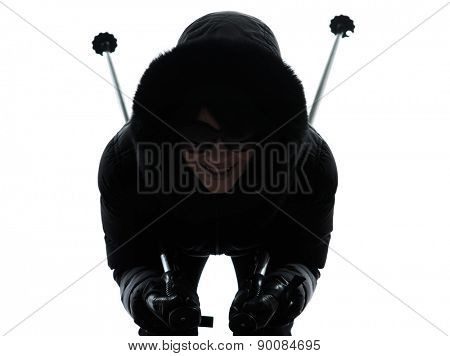 one woman in winter coat happy skiing portrait silhouette on white background