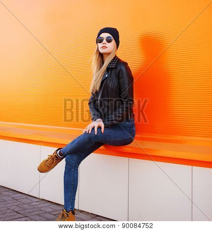 Street Fashion Concept - Stylish Woman In Rock Black Style Posing Against A Colorful Urban Wall