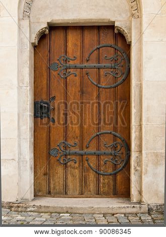 Brown Wooden Door in White Stone