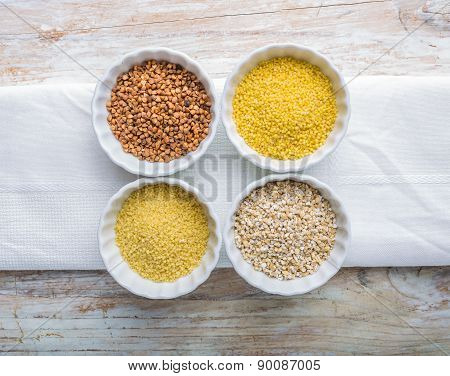 Types Of Grain Groats On A White Wood