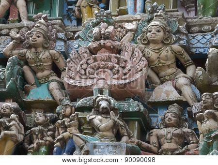 Group of Statues Around Two Dwarapalakas on Gopuram.