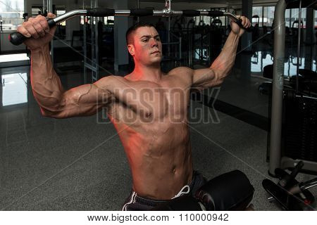 Young Male Doing Back Exercises In The Gym