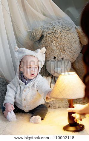 Cute Happy Baby Boy  Sitting On Fur