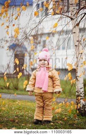 Cute Smiling Little 2 Years Old Girl In The Autumn Park In Sunny