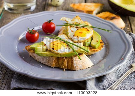 Toast With Fried Quail Eggs And Avocado