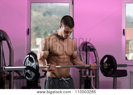 Young Man Lifting Weights With Barbell