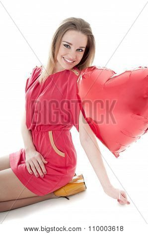 Smiling Woman With Red Heart Balloon