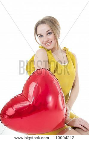Smiling Woman With Red Heart Balloon  On White Background