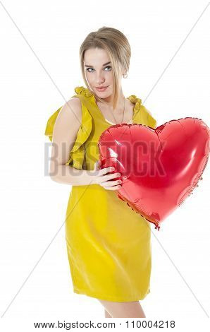 Beautiful Woman Holding Red Heart Balloon Over White Background. Valentines Day Concepts.