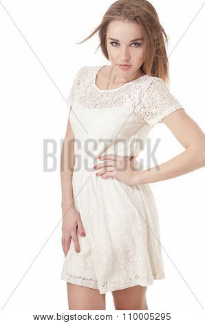 Seductive Young Girl Dressed In A Short White Dress, Isolated On White Background.
