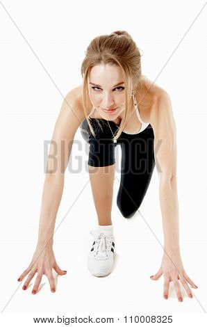 Athletic Woman In A Position Ready To Run