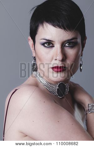 Single, Sensual gesture girl dressed in the style of 20s and 30s