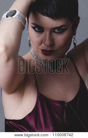dancer flapper with short black hair and jewelry