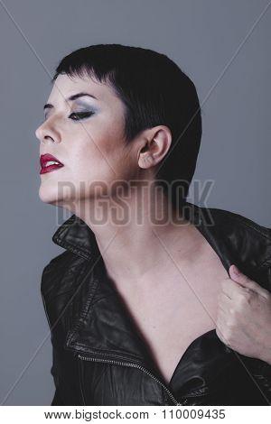 serious gesture girl dressed in black leather jacket