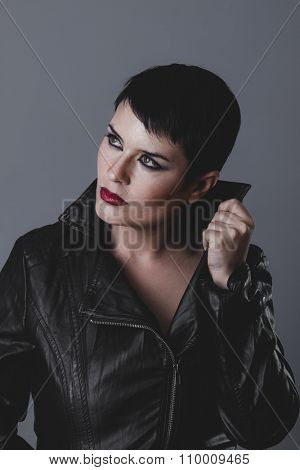 heavy, sensual and rebellious girl with black leather jacket