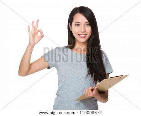 Asian Young Woman hold with file board and ok sign gesture