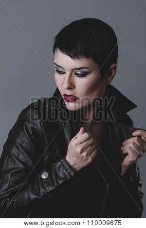 star, serious gesture girl dressed in black leather jacket