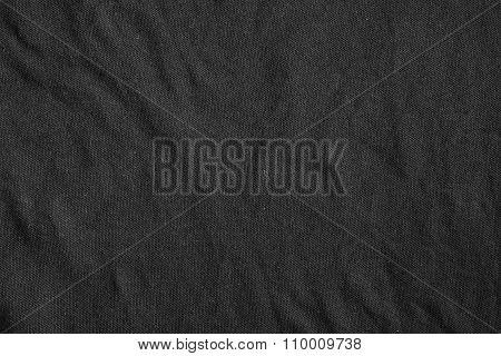 Black canvas with delicate striped pattern crumpled.