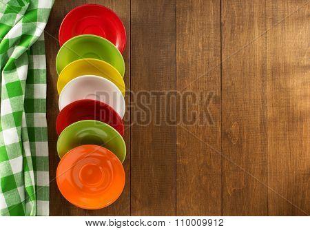 set of saucer on wooden background