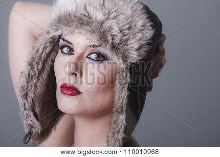 naked girl with Russian winter hat, cold
