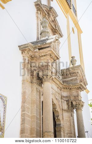 church facade with yellow trim in Marbella, Andalucia Spain