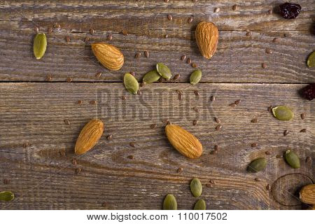 grains, seeds, and the seeds scattered on wooden background