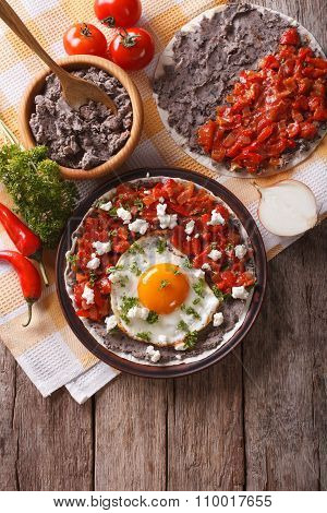 Mexican Huevos Rancheros On The Plate. Vertical Top View