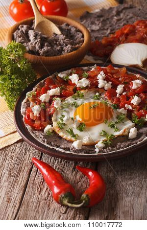 Mexican Breakfast: Huevos Rancheros Close-up. Vertical