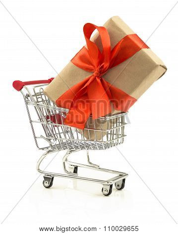 Gift With Red Bow In The Shopping Cart