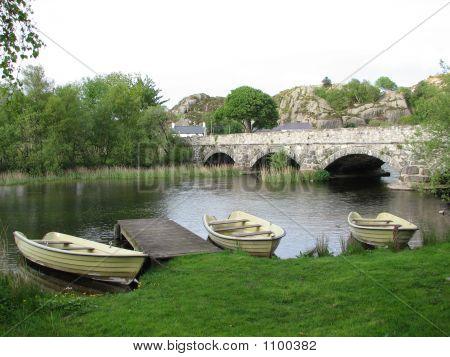 Resting Boats Near Bridge