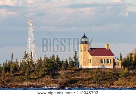 Brick Lighthouse With Red Roof In Warm Light