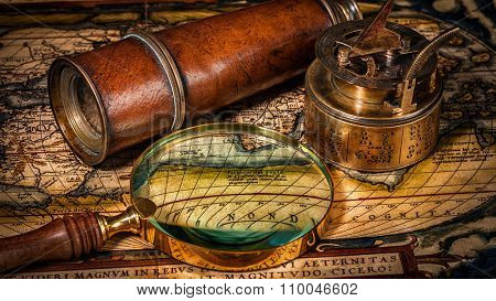 Travel geography navigation concept background - panorama of old vintage retro compass with sundial, spyglass and magnifying glass on ancient world map