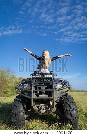 Elegant Woman Riding Extreme Quadrocycle Atv