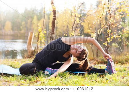 Pretty Woman In Yoga Parivrtta Janu Sirsasana - Head To Knee Pose