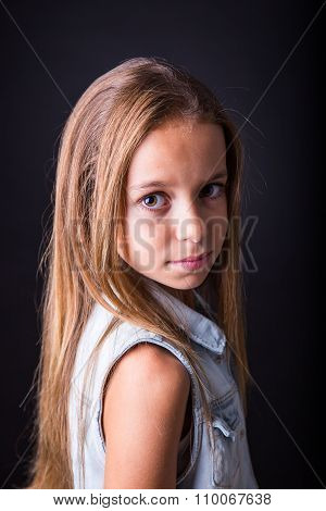 Young Girl With Sober Look On Black Background