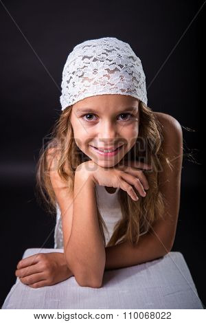 Young Girl With White Cap Smiling